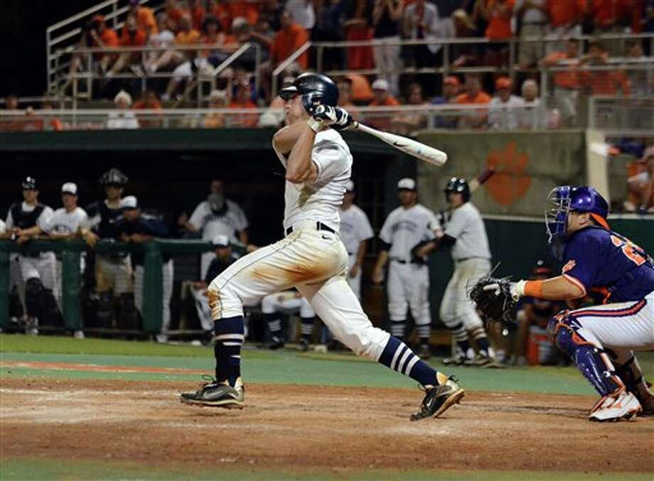 Connectocut's Ryan Fuller gets a base hit to drive in the winning run to defeat Clemson 7-6 during an NCAA college baseball regional tournament game against Clemson at Doug Kingsmore Stadium Sunday, June 5, 2011, in Clemson, S.C. (AP Photo/ Richard Shiro) Photo: AP