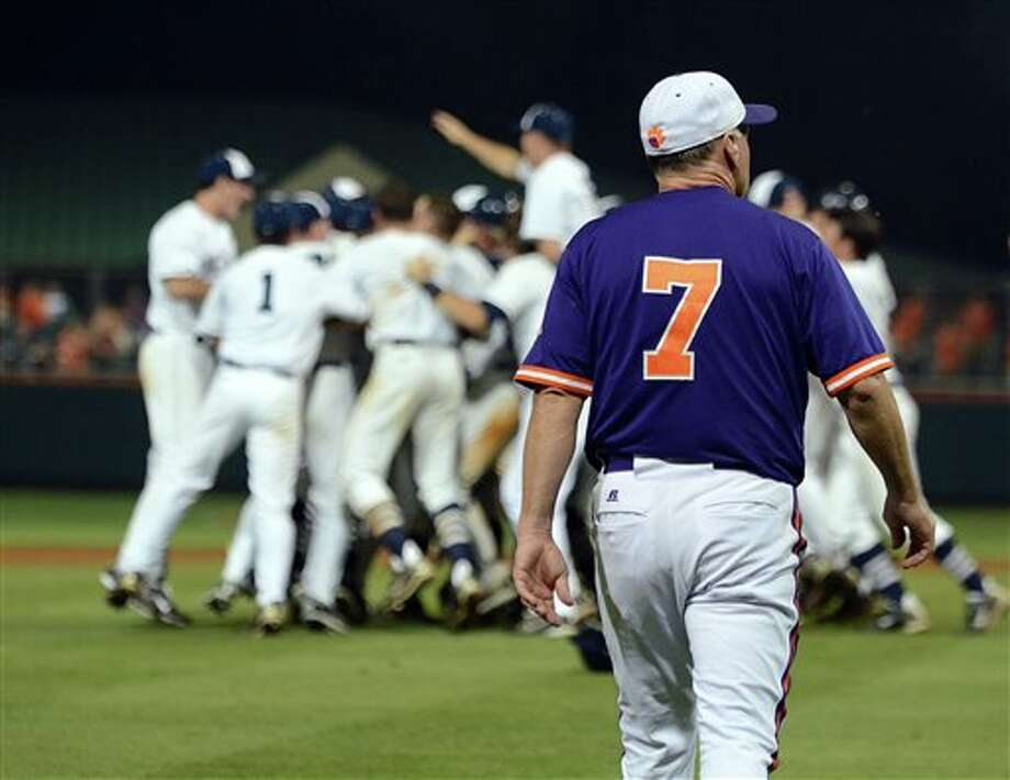 Clemson head coach Jack Leggett walks across the diamond after a 7-6 defeat to Connecticut during an NCAA college baseball regional tournament game against Clemson at Doug Kingsmore Stadium Sunday, June 5, 2011, in Clemson, S.C. (AP Photo/ Richard Shiro) Photo: AP