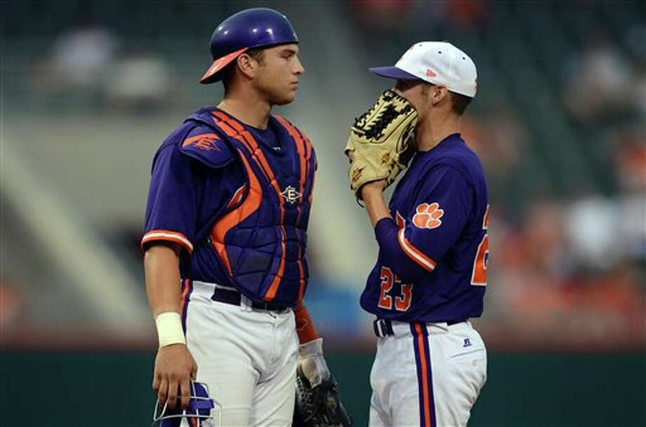 Clemson catcher Spencer Kieboom (left) has a discussion with pitcher Justin Sarratt during an NCAA college baseball regional tournament game against Connecticut at Doug Kingsmore Stadium Sunday, June 5, 2011, in Clemson, S.C. (AP Photo/ Richard Shiro) Photo: AP
