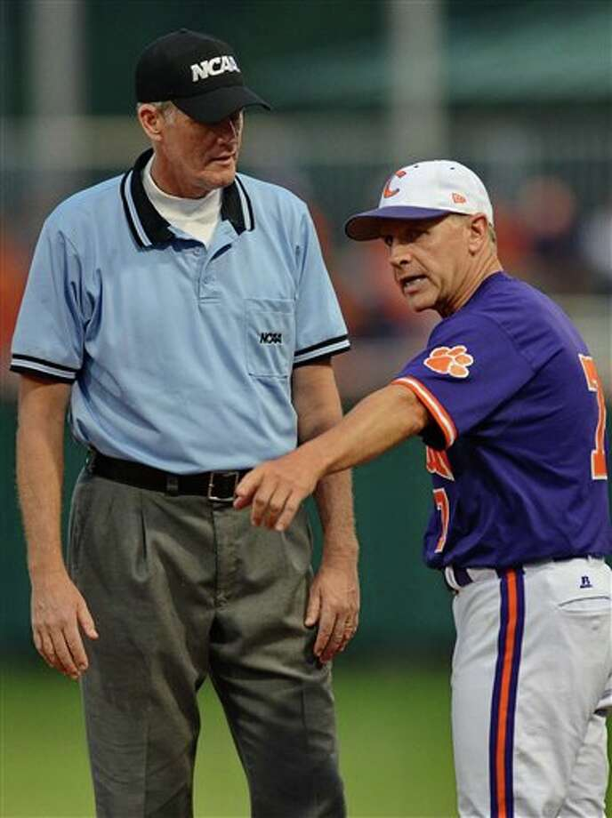Clemson head coach Jack Leggett (right) discusses a previous play with the umpire during an NCAA college baseball regional tournament game against Connecticut at Doug Kingsmore Stadium Sunday, June 5, 2011, in Clemson, S.C. (AP Photo/ Richard Shiro) Photo: AP