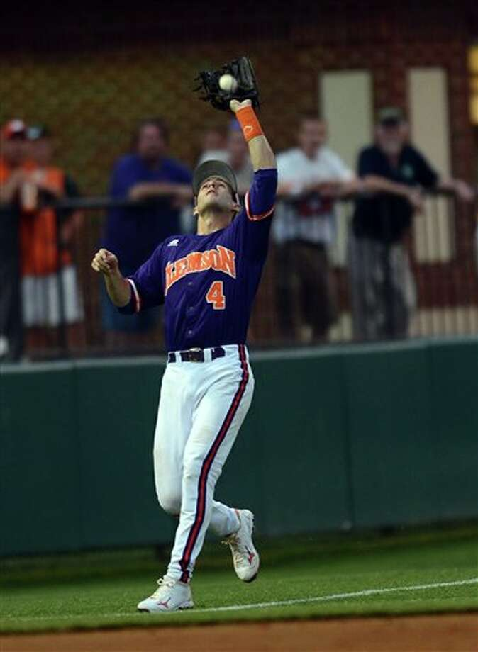 Clemson left fielder John Hinson makes a play during an NCAA college baseball regional tournament game against Connecticut at Doug Kingsmore Stadium Sunday, June 5, 2011, in Clemson, S.C. (AP Photo/ Richard Shiro) Photo: AP