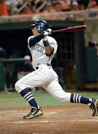 Connecticut's  L.J. Mazzilli  hits a single in the bottom of the fifth during an NCAA college baseball regional tournament game against Clemson at Doug Kingsmore Stadium Sunday, June 5, 2011, in Clemson, S.C. (AP Photo/ Richard Shiro) Photo: AP