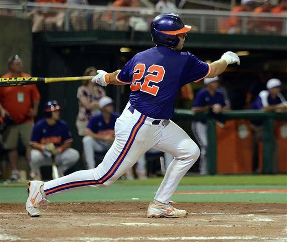 Clemson's Spencer Kieboom grinds out a RBI single during an NCAA college baseball regional tournament game against Connecticut at Doug Kingsmore Stadium Sunday, June 5, 2011, in Clemson, S.C. (AP Photo/ Richard Shiro) Photo: AP
