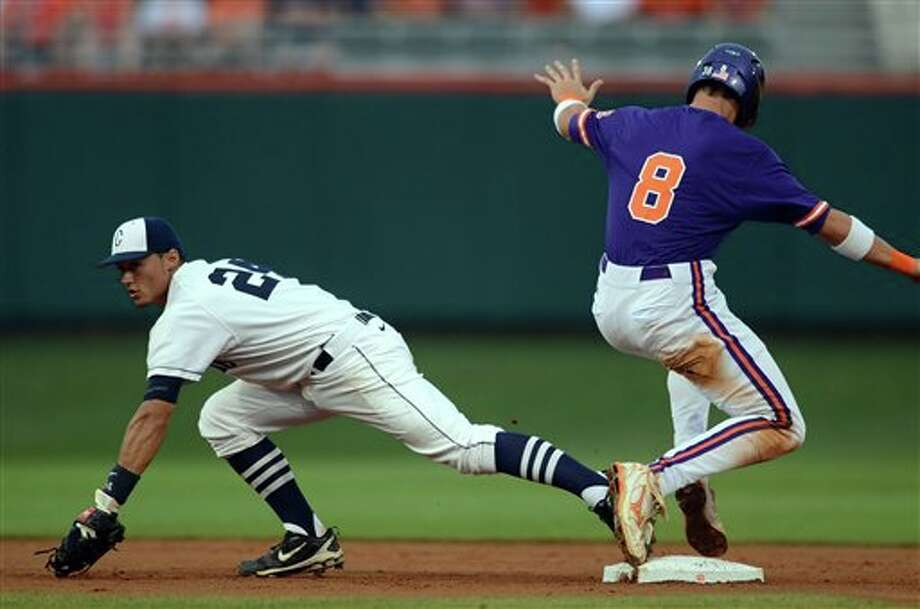 Clemson's Richie Shaffer(right)  beats the tag of Connecticut second baseman L.J. Mazzilli during an NCAA college baseball regional tournament game at Doug Kingsmore Stadium Sunday, June 5, 2011, in Clemson, S.C. (AP Photo/ Richard Shiro) Photo: AP