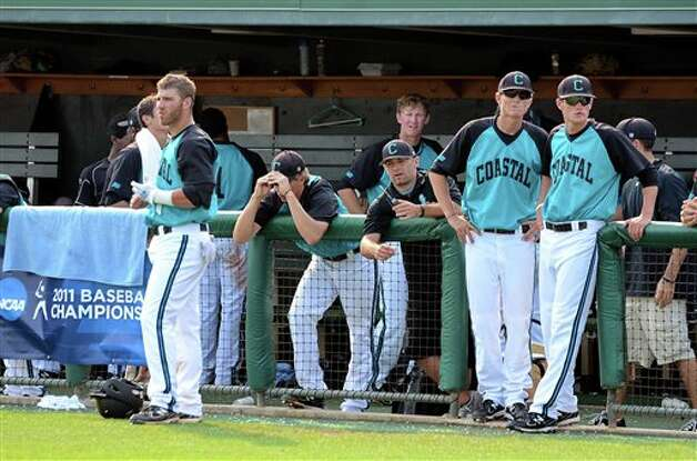 Coastal Carolina players watch as they lost to Connecticut 12-6 at an NCAA college baseball regional tournament game at Doug Kingsmore Stadium Sunday, June 5, 2011, in Clemson, S.C. (AP Photo/ Richard Shiro) Photo: AP