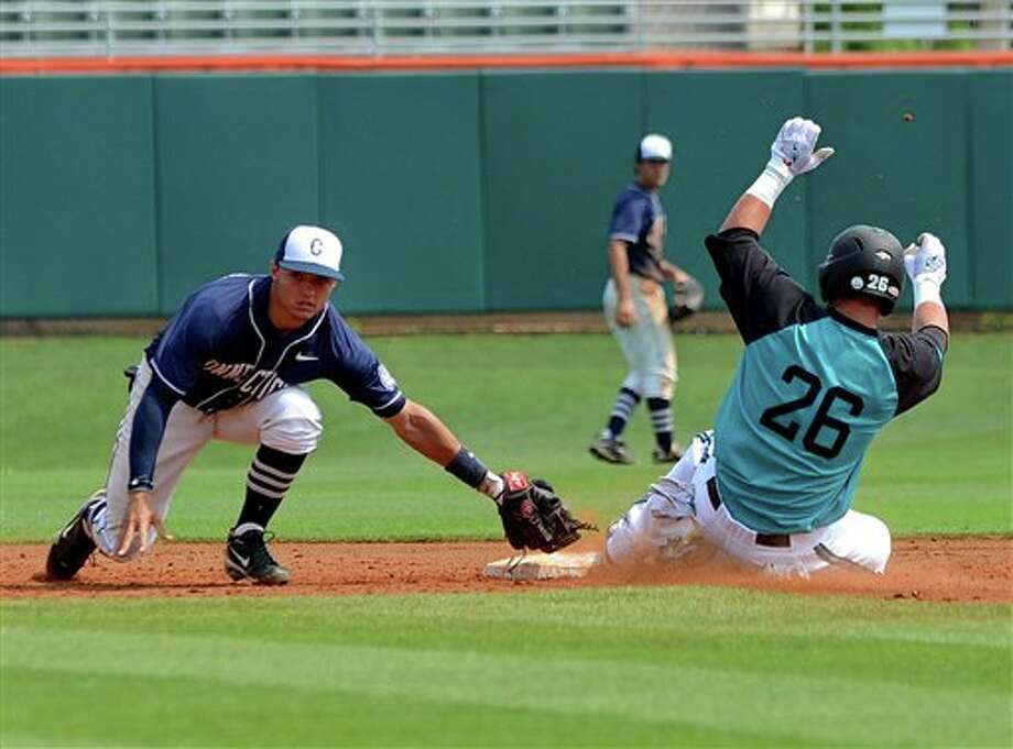 Connecticut shortstop Nick Ahmed (left) tags out Coastal Carolina's Daniel Bowman at second base during an NCAA college baseball regional tournament game at Doug Kingsmore Stadium Sunday, June 5, 2011, in Clemson, S.C. (AP Photo/ Richard Shiro) Photo: AP
