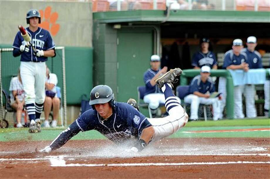 Connecticut's George Springer steals home during an NCAA college baseball regional tournament game against Coastal Carolina at Doug Kingsmore Stadium Sunday, June 5, 2011, in Clemson, S.C. (AP Photo/ Richard Shiro) Photo: AP