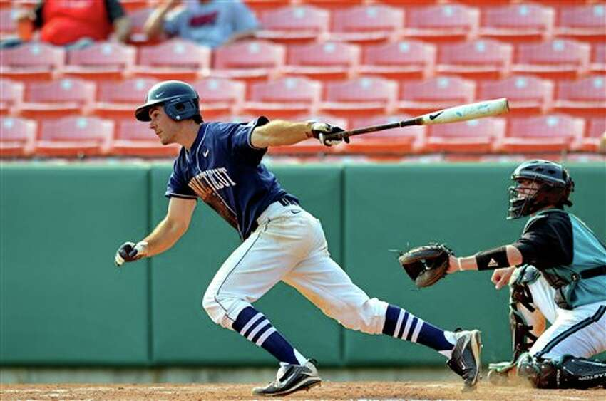 Connecticut's Billy Ferriter releases the bat after getting a hit during an NCAA college baseball regional tournament game against Coastal Carolina at Doug Kingsmore Stadium Sunday, June 5, 2011, in Clemson, S.C. (AP Photo/ Richard Shiro)