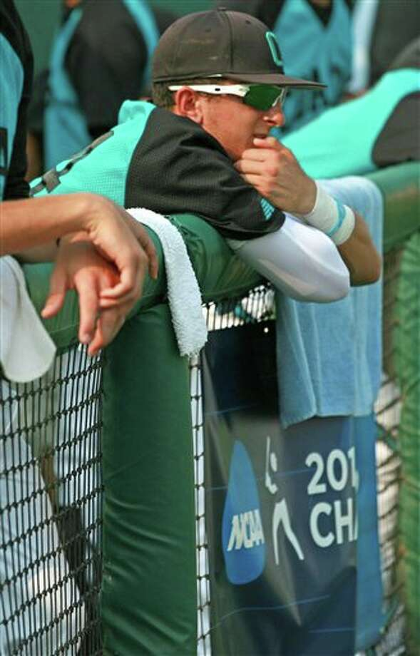 Coastal Carolina player Zach Lopes looks out of the dugout railing after the Chanticleers were eliminated in an NCAA regional tournament baseball game against Connecticut on Sunday, June 5, 2011 in Clemson, S.C. Connecticut won, 12-6.  (AP Photo/Anderson Independent-Mail, Mark Crammer) Photo: AP