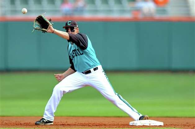 Coastal Carolina shortstop Taylor Motter makes a play at second during an NCAA college baseball regional tournament game against Connecticut at Doug Kingsmore Stadium Sunday, June 5, 2011, in Clemson, S.C. (AP Photo/ Richard Shiro) Photo: AP