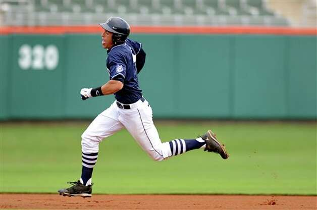 Connecticut's George Springer rounds the bases during an NCAA college baseball regional tournament game against Coastal Carolina at Doug Kingsmore Stadium Sunday, June 5, 2011, in Clemson, S.C. (AP Photo/ Richard Shiro) Photo: AP
