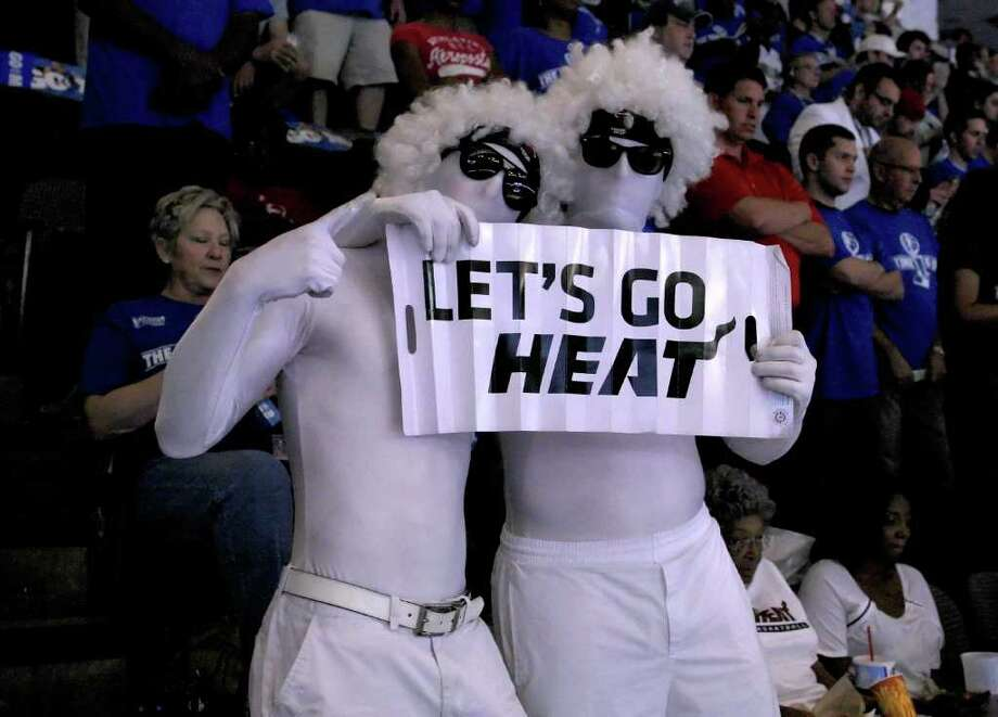 DALLAS, TX - JUNE 05:  Fans of the Miami Heat support their team as they seat amongst Dallas Mavericks fans in Game Three of the 2011 NBA Finals at American Airlines Center on June 5, 2011 in Dallas, Texas.  NOTE TO USER: User expressly acknowledges and agrees that, by downloading and/or using this Photograph, user is consenting to the terms and conditions of the Getty Images License Agreement. Photo: Chris Chambers, Getty Images / 2011 Getty Images