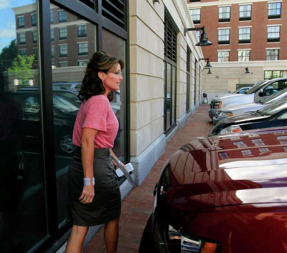 Former Alaska Gov. Sarah Palin leaves out of the back door of her hotel Thursday, June 2, 2011, in Portsmouth, N.H., as she continues her East Coast tour. Photo: Jim Cole, AP / AP