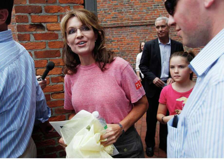Former Alaska Gov. Sarah Palin, accompanied by her youngest daughter Piper, right, tours Boston's North End neighborhood, Thursday, June 2, 2011. Photo: Steven Senne, AP / AP