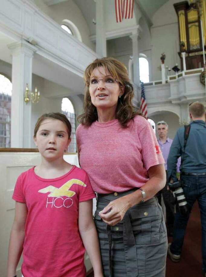 Former Alaska Gov. Sarah Palin and her youngest daughter Piper tour the Old North Church in Boston's North End neighborhood, Thursday, June 2, 2011. Photo: Steven Senne, AP / AP