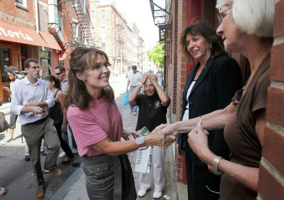 Former Alaska Gov. Sarah Palin greets people as she tours Boston's North End neighborhood, Thursday, June 2, 2011. Photo: Steven Senne, AP / AP