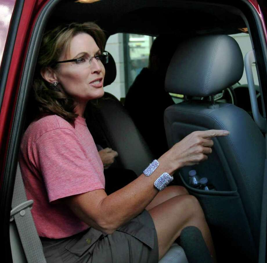 Former Alaska Gov. Sarah Palin gets in her car Thursday, June 2, 2011, in Portsmouth, N.H., as she continues her East Coast tour. Photo: Jim Cole, AP / AP