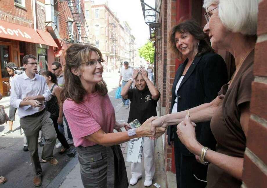 Former Alaska Gov. Sarah Palin greets people as she tours Boston's North End neighborhood, Thursday, June 2, 2011. Photo: Steven Senne, AP / AP