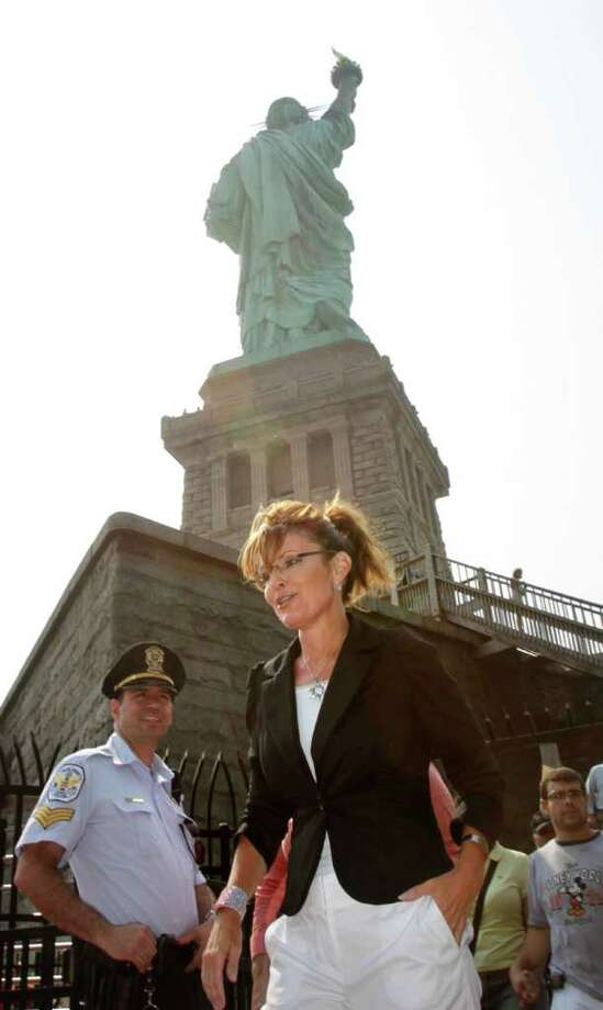 Sarah Palin exits the Statue of Liberty on Liberty Island in New York, Wednesday, June 1, 2011. Photo: Seth Wenig, AP / AP