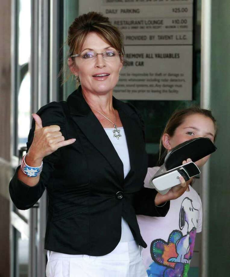 Former Alaska Gov. Sarah Palin is seen with her daughter Piper outside the Hyatt Regency hotel, Wednesday, June 1, 2011 in Jersey City, N.J. Photo: Julio Cortez, AP / AP