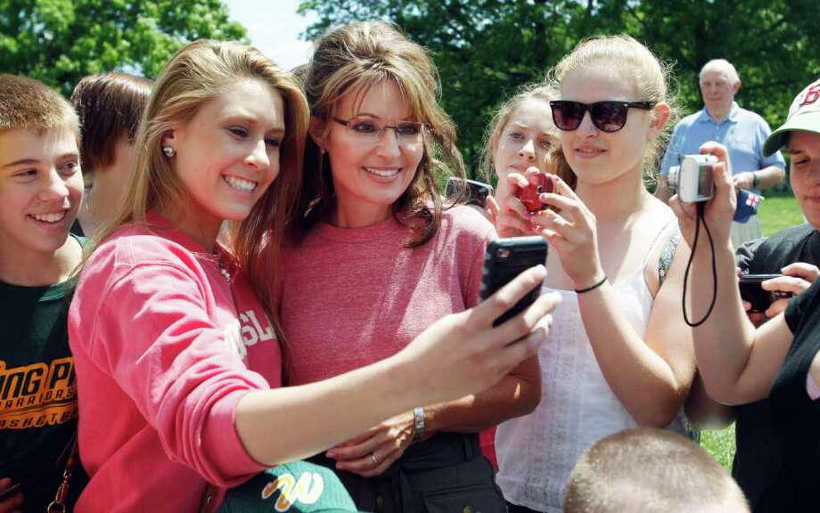 Former Alaska Gov. Sarah Palin poses for photos with a school group visiting the Bunker Hill Monument in Boston, Thursday, June 2, 2011. Photo: Steven Senne, AP / AP