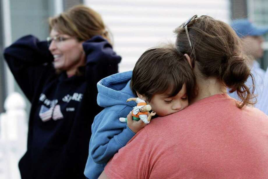 A child rests as former Alaska Gov. Sarah Palin visits a clambake in Seabrook, N.H., Thursday June 2, 2011. Palin has been visiting East coast cities this past week. Photo: Charles Krupa, AP / AP
