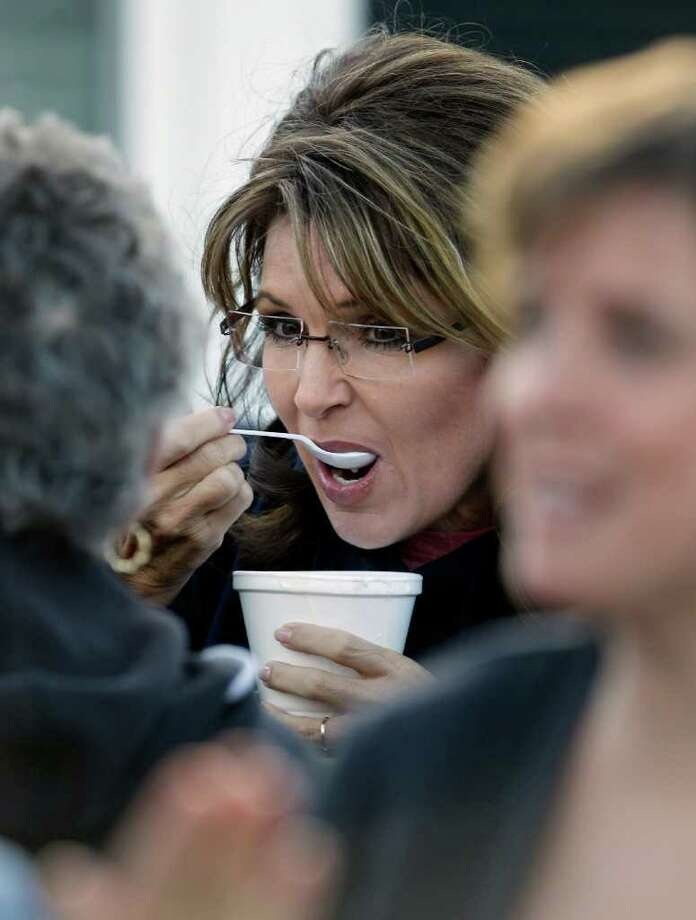 Former Alaska Gov. Sarah Palin tries a bowl of clam chowder at a clambake in Seabrook, N.H., Thursday June 2, 2011. Palin has been visiting East coast cities this past week. Photo: Charles Krupa, AP / AP