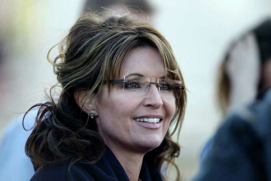 Former Alaska Gov. Sarah Palin listens to guests at a clambake in Seabrook, N.H., Thursday, June 2, 2011. Palin has been visiting East coast cities this past week. Photo: Charles Krupa, AP / AP