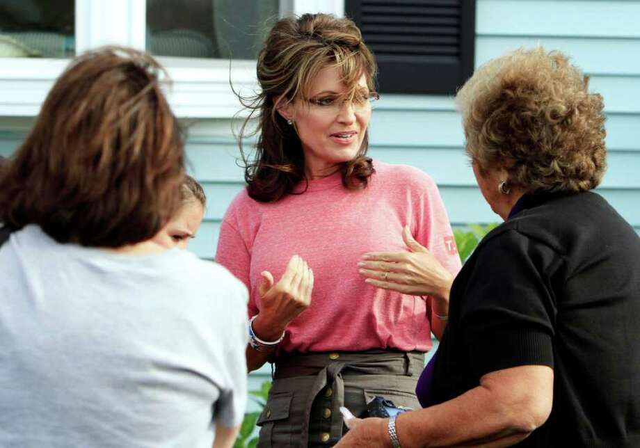 Former Alaska governor and vice presidential candidate Sarah Palin talks with guests at a house party, Thursday, June 2, 2011 in Seabrook, N.H. Photo: Jim Cole, AP / AP