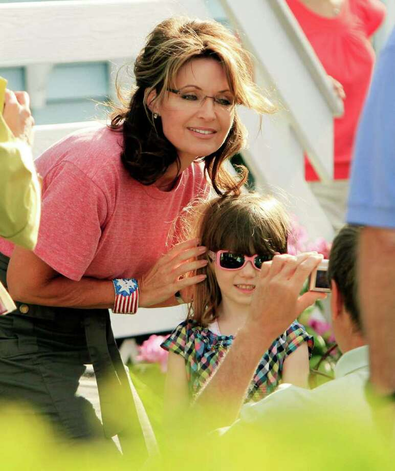Former Alaska governor and vice presidential candidate Sarah Palin poses for a photo at a house party, Thursday, June 2, 2011, in Seabrook, N.H. Photo: Jim Cole, AP / AP