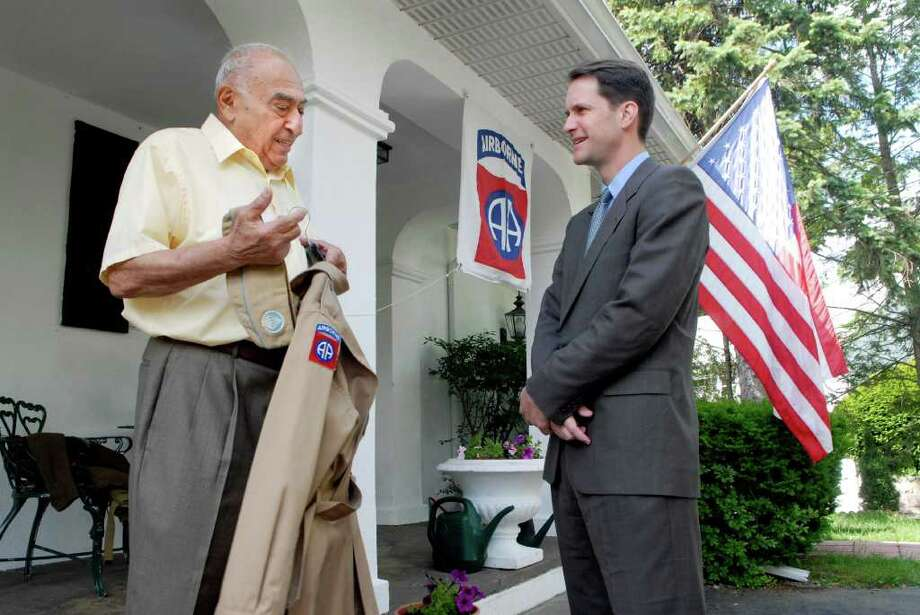 Harry Kouzoujian is interviewed by Congressman Jim Himes at Kouzoujian's Stamford, Conn. home on Monday June 6, 2011. Kouzoujian is a veteran of WWII and was a paratrooper in the 508 of the 82nd Airborne. On his 21st birthday he jumped as part of the D-Day invasion. He was captured, spent 11 months in a prison camp, and was eventually liberated by the Russians Photo: Dru Nadler / Stamford Advocate Freelance