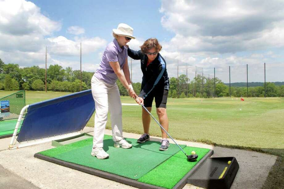 Angela Aulenti, head golf pro at Sterling Farms Golf Course in Stamford, Conn., gives Elish Hickey of Greenwich a golf lesson on Monday June 6, 2011. Photo: Dru Nadler / Stamford Advocate Freelance
