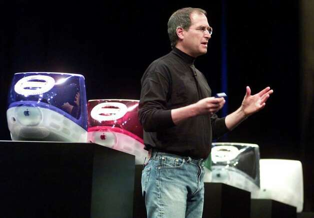 Steve Jobs, CEO of Apple Computer Inc., shows off new colors for updated iMac computers at macWorld Expo in New York, Wednesday July 19, 2000. The iMac models come in new colors: dark blue, emerald, deep red and white, and are priced at $799, $999. $1,299 and $1,499. The last time Apple updated its line of brightly colored iMacs was in October 1999. The machine, credited with helping Apple rebound from years of declining market share, is two years old this summer. Photo: RICHARD DREW, AP / AP