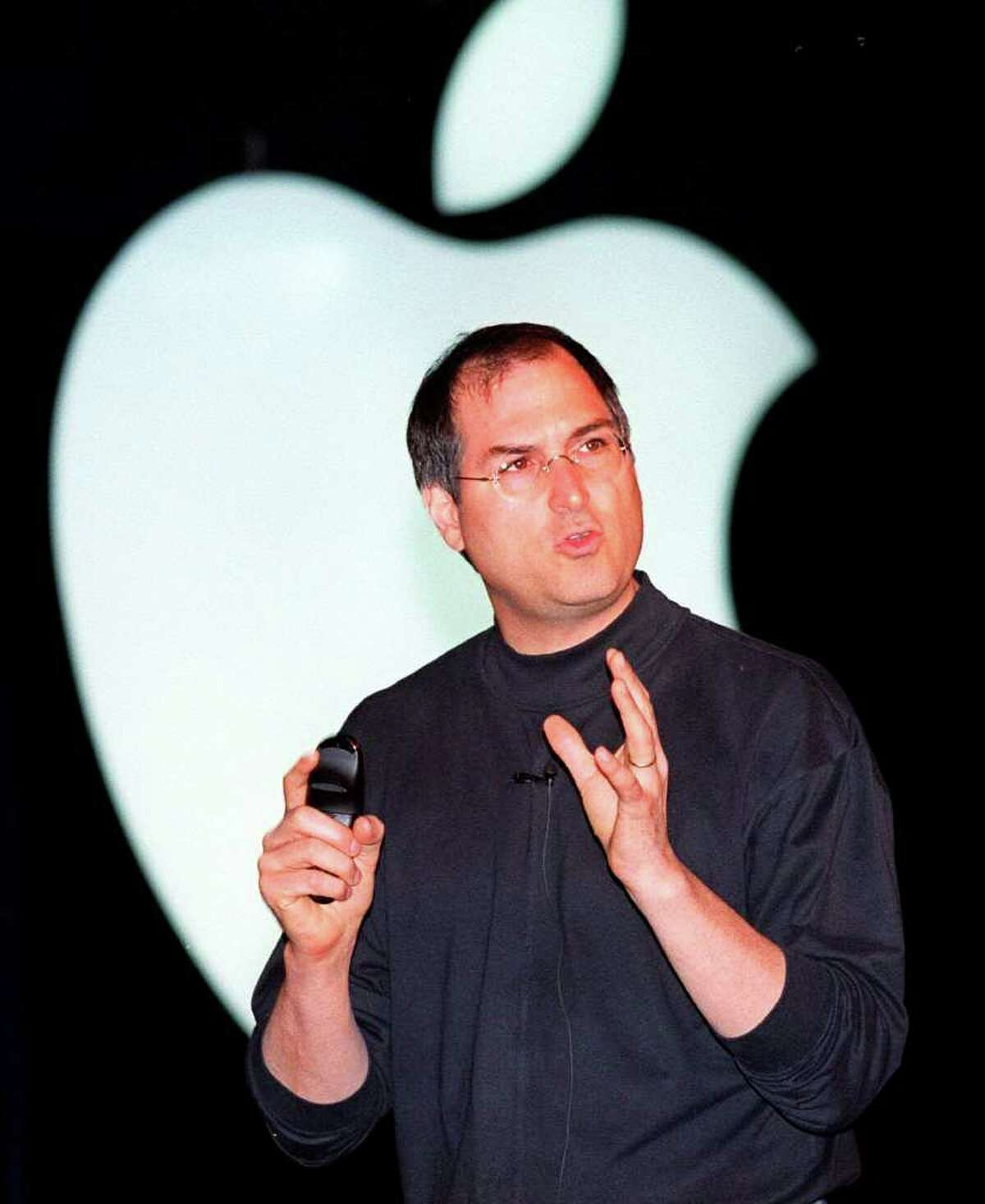 Steve Jobs, interim chief executive at Apple Computer, gestures while deilvering the keynote speech at the MacWorld Expo Wednesday, July 8, 1998, in New York. Jobs said the company will report its third straight quarterly profit next week for the quarter ended June 30, continuing its turnaround after losing $1.8 billion in its two previous fiscal years. (AP Photo/Staurt Ramson)