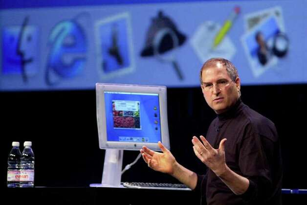 Apple Computers Inc. Chief Executive Steve Jobs displays the desktop from the new Mac OS X during Apple's World Wide Developer Conference in San Jose, Calif., Monday, May 15, 2000.  Jobs announced Apple will delay shipping by several months its most ambitious upgrade ever to its Macintosh operating system to give developers time to create accompanying software. Photo: PAUL SAKUMA, AP / AP