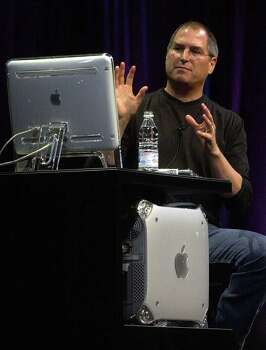 Apple CEO Steve Jobs demonstrates the new Apple 10.1 operating system on the new Power Mac G4 at the MacWorld Expo, Wednesday ,July 18, 2001 in New York. Apple also said it expects revenues for the second half of the year to be around $3 billion, compared to the previous range of $3.2 billion to $3.4 billion, causing shares to drop 17 percent. Photo: SUZANNE PLUNKETT, AP / AP