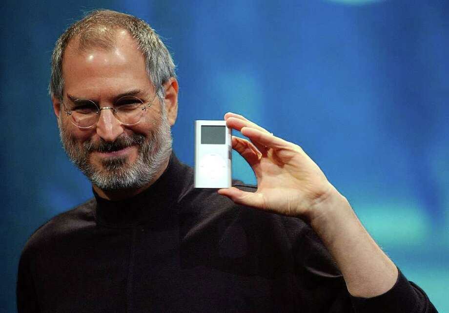 Apple CEO Steve Jobs displays his company's new product, the Mini-Ipod, at the Macworld Conference and Expo in San Francisco, Tuesday, Jan. 6, 2004. Photo: MARCIO JOSE SANCHEZ, AP / AP