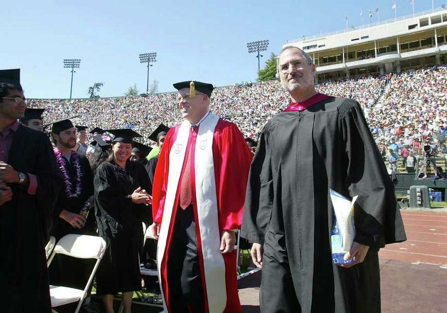 Apple Computers Inc. CEO Steve Jobs, right, walks with Stanford President John Hennessy, before Jobs spoke at the graduation ceremonies at Stanford University, in Palo Alto, Calif., Sunday, June 12, 2005. Photo: JACK ARENT, AP / PALO ALTO DAILY NEWS
