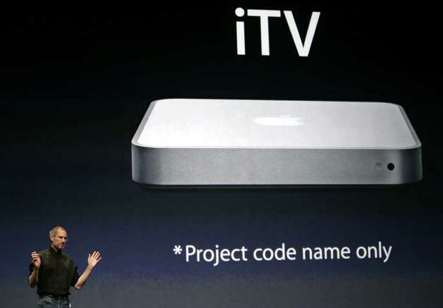 Apple Computer CEO Steve Jobs gestures as he unveils iTV during announcement at an Apple event in San Francisco, Tuesday, Sept. 12, 2006. Apple Computer launched its long-awaited online movie service Tuesday with minimal participation from Hollywood and showed off a device that will make it easier for consumers to watch the videos on television. Photo: PAUL SAKUMA, AP / AP
