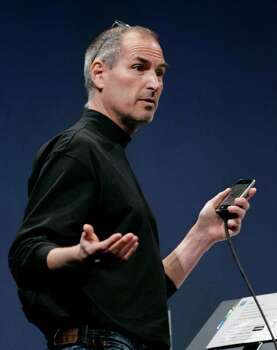 Apple CEO Steve Jobs gestures during his keynote address about Apple's iPhone at MacWorld Conference & Expo in San Francisco, in this file photo from  Jan. 9, 2007.  Jobs defended the company's handling of its stock options-backdating scandal and suggested that a former employee's accusations of his role in the matter were off-the-mark when he met with shareholders Thursday. Photo: Paul Sakuma, AP / AP