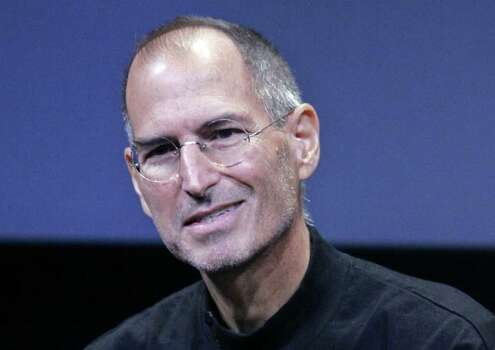 In this Oct. 14, 2008 file photo, Apple CEO Steve Jobs smiles during a product announcement at Apple headquarters in Cupertino, Calif. Photo: Paul Sakuma, AP / AP