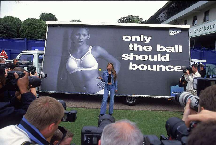 Kournikova launches an ad campaign for the Berlei Shock Absorber Bra on June 16, 2000, at Devonshire Park, England. No comment. Photo: Phil Cole, Getty Images / Getty Images Europe