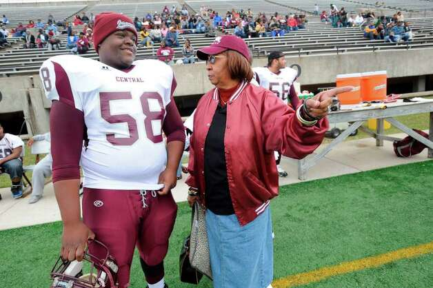Grandma Jaguar,  Enolia Bolt, right, offers words of encouragement to offensive lineman Jahmad Ashford before the start of the Jaguars third round playoff matchup against the Friendswood Mustangs at Baytown's Stallworth Stadium. Saturday,  November 28, 2009. Valentino Mauricio/The Enterprise Photo: Valentino Mauricio / Beaumont