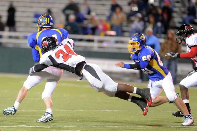 Kirbyville's Aaron Breed (34) gets the tackle on Comfort's Will Pace during the first half of their Class 2A Division I state s