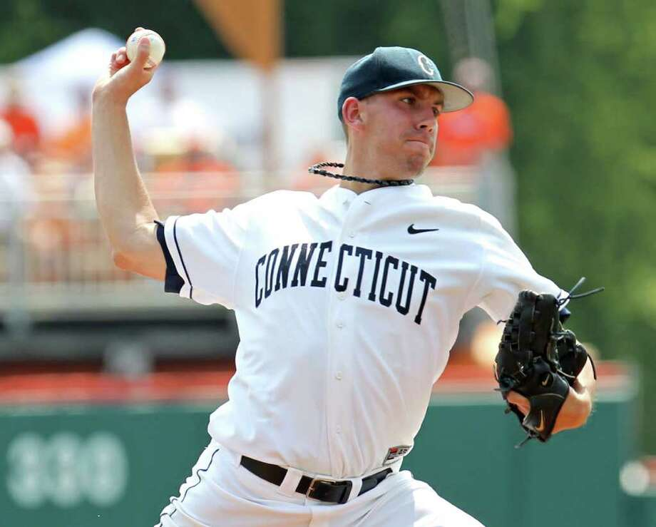 Connecticut pitcher Matt Barnes throws a pitch during an NCAA Regional baseball tournament game against Coastal Carolina at Doug Kingsmore Stadium in Clemson, S.C. on Friday, June 3, 2011. (AP Photo/Anderson Independent-Mail, Mark Crammer) Photo: AP