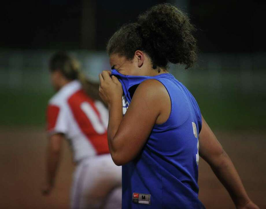 Darien shortstop and team captain Nicole Buch wipes away tears after her team's loss to Foran in the Class L semifinals at DeLuca Field in Stratford on Monday, June 6, 2011. Photo: Brian A. Pounds / Connecticut Post