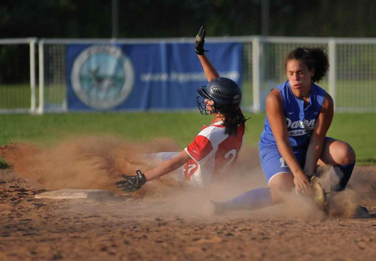 Foran's Brooke Phelan slides safely into second base around Darien shortstop Nicole Buch in the first inning of their Class L semifinal at DeLuca Field in Stratford on Monday, June 6, 2011. Foran scored two runs in the inning and won the game 4-1.