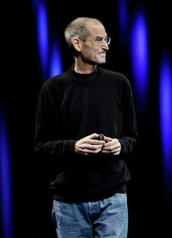 Apple CEO Steve Jobs smiles as he is applauded during a keynote address to the Apple Worldwide Developers Conference in San Francisco, Monday, June 6, 2011.  (AP Photo/Paul Sakuma) Photo: Paul Sakuma