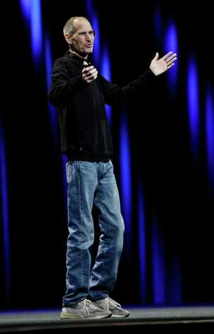 Apple CEO Steve Jobs gestures during a keynote address to the Apple Worldwide Developers Conference in San Francisco, Monday, June 6, 2011. (AP Photo/Paul Sakuma) Photo: Paul Sakuma