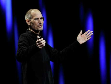 Apple CEO Steve Jobs gestures to his audience during a keynote address to the Apple Worldwide Developers Conference in San Francisco, Monday, June 6, 2011.  (AP Photo/Paul Sakuma) Photo: Paul Sakuma